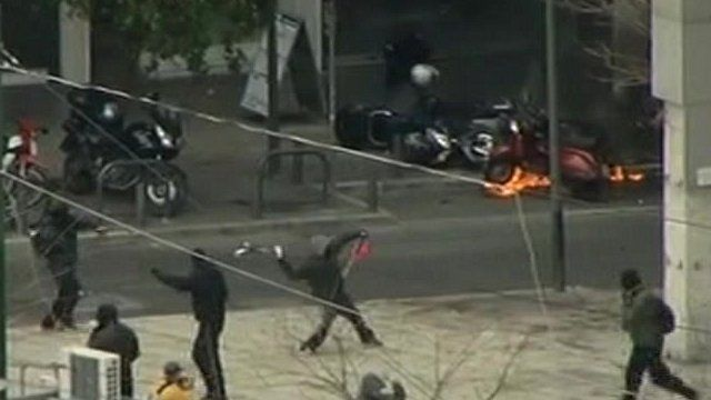 Petrol bombs were thrown at security forces in Athens.