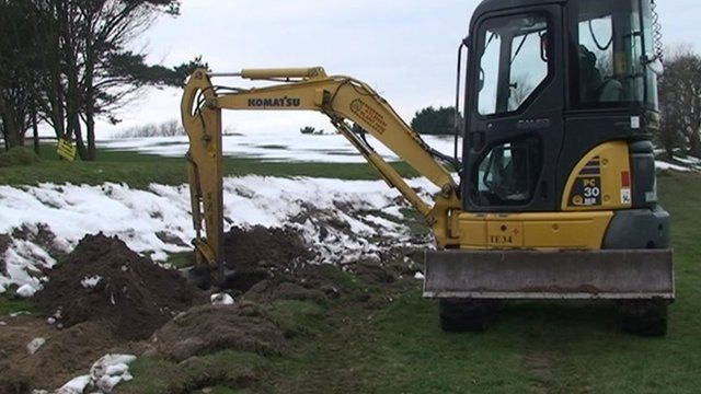 Digger excavating a site