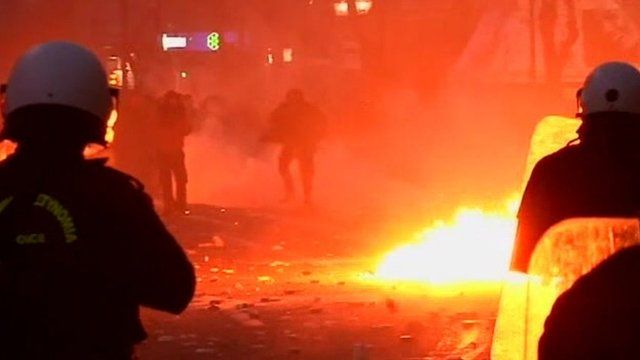 Protesters throw petrol bombs at riot police