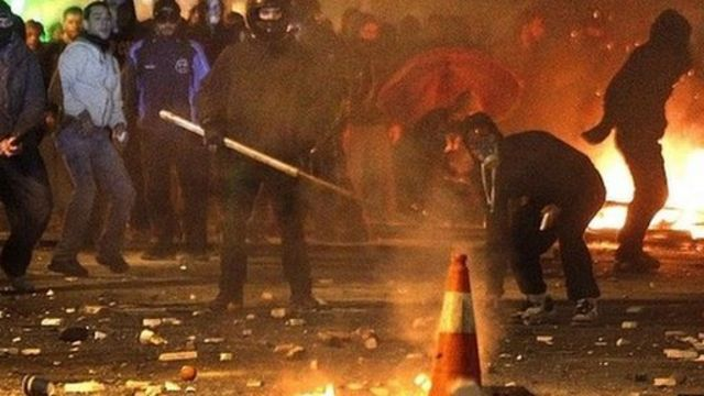 Protesters fighting police