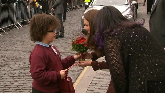 The Duchess of Cambridge receives flowers from a child