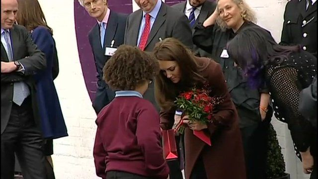The Duchess of Cambridge accepting a gift