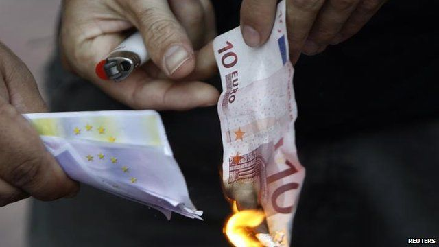 Protester sets fire to euro note