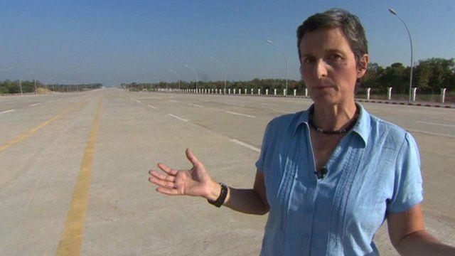 The BBC's Rachel Harvey walks an empty highway in Burma's capital city
