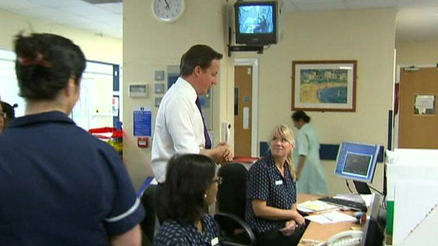 David Cameron chats to staff in an NHS hospital.