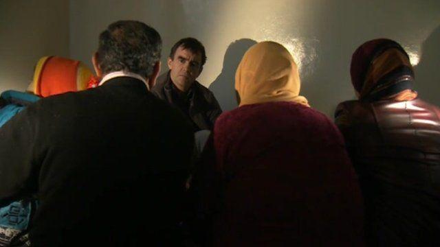 Civilians talk to the BBC's Wyre Davies