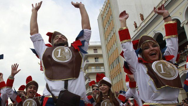 Participants in a parade in Patras, Greece dressed as euro coins
