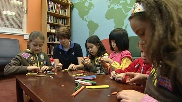 Girl guides making things with their leader