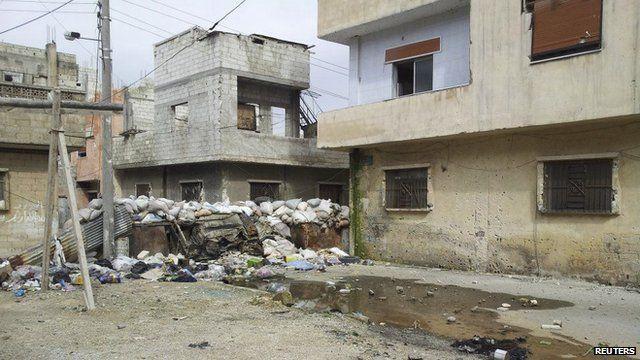 Damaged houses in Karm Al Zaytoon, a neighbourhood of Homs