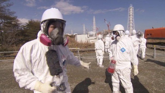 Roland Buerk in protective suit inside Fukushima plant
