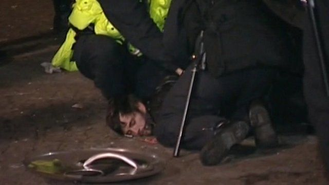 An Occupy protester being held by police