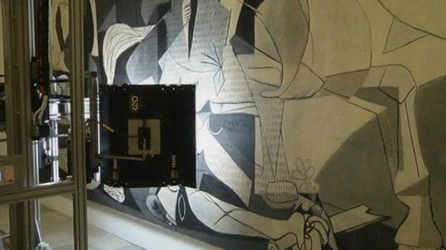 The robotic camera takes an image of Picasso's Guernica