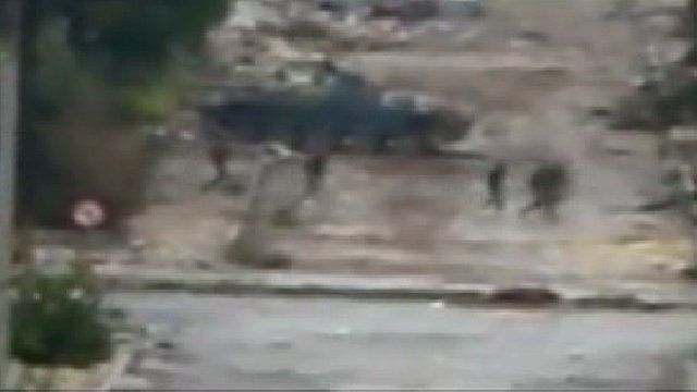 Tank and soldiers in Al Inshaat district in Homs, Wednesday