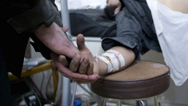 Wounded man being treated in the Baba Amr district of Homs in Syria