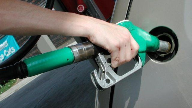 Filling a car with petrol