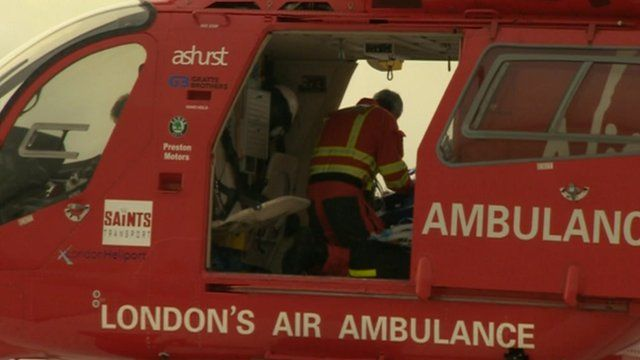 Staff working on a patient inside the air ambulance
