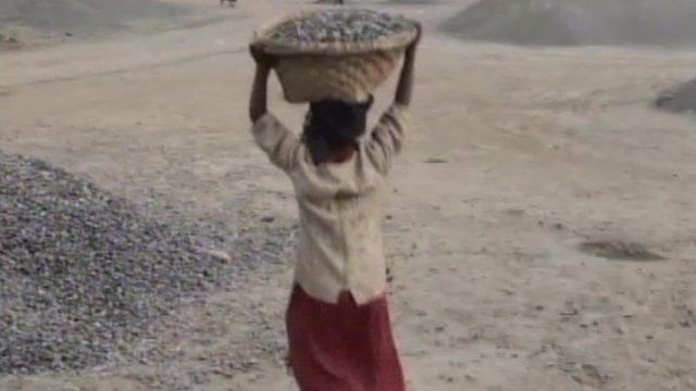 A child carries rocks