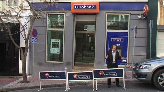 The BBC's Mark Lowen outside Eurobank in Athens.