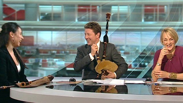 The BBC's Charlie Stayt tries to play the bagpipes