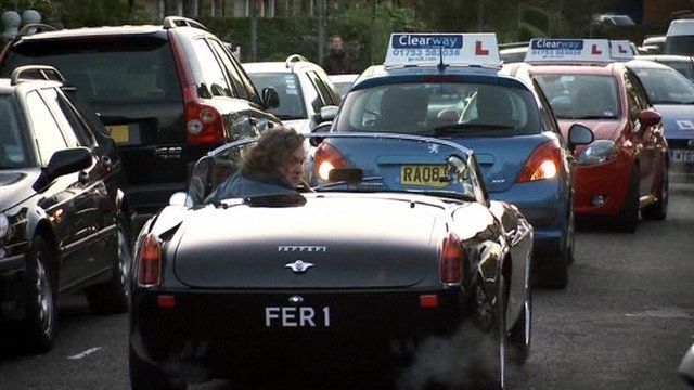 In this scene from Top Gear James May reverses after being stopped by three  cars with learner plates