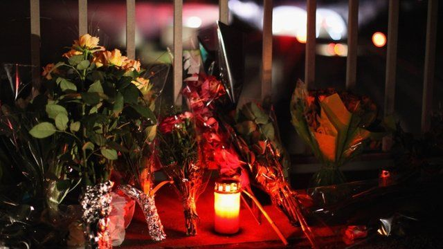 Flowers and candles near the scene