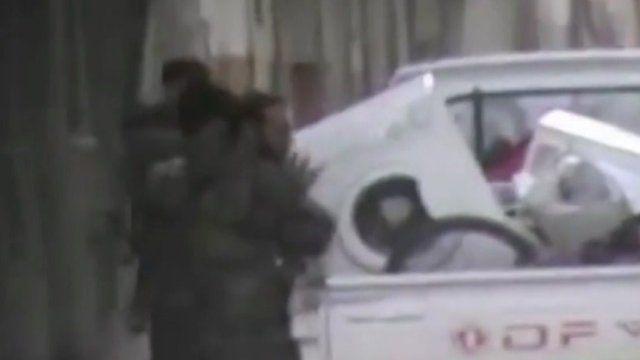 Men lifting washing machine onto truck