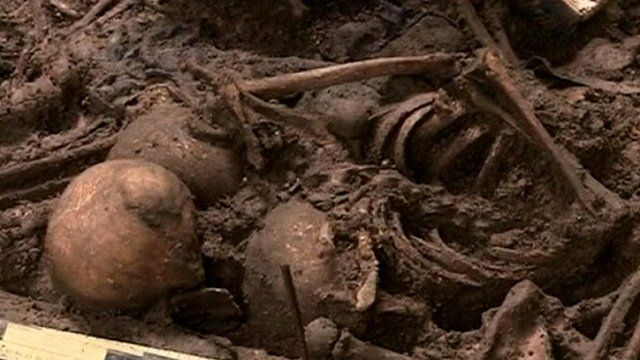 Human remains in one of the mass graves