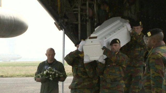 Coffins taken from plane