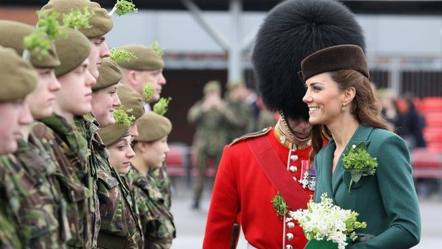 The Duchess of Cambridge hands our shamrocks to the guards