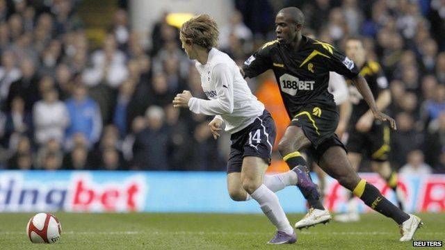 Tottenham's Luka Modric runs with the ball next to Bolton Wanderers' Fabrice Muamba