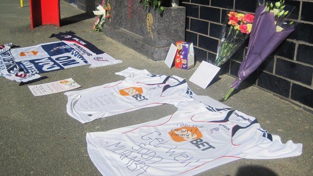 Shirts bearing get well messages outside the Reebok Stadium in Bolton
