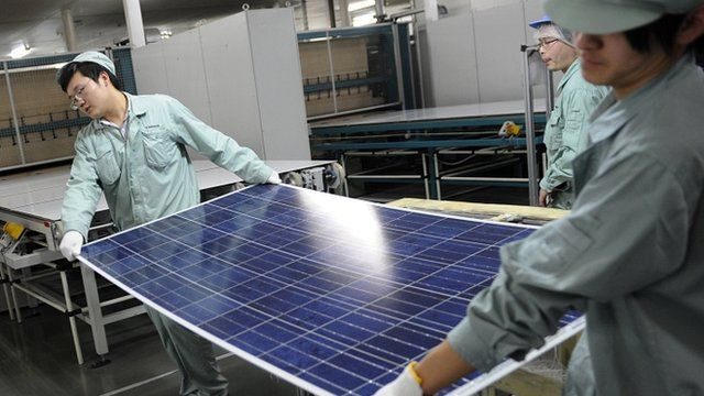 Workers assembling solar panels in Wuxi, China