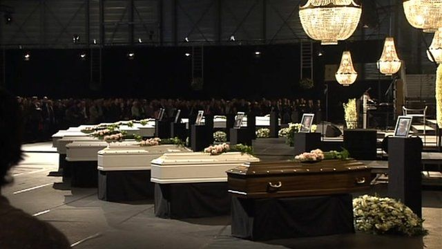 Mourners in the northern Belgium town of Lommel attend service for some victims of the bus crash in Switzerland