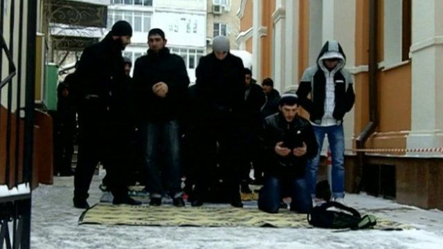 Muslims pray on the street in Moscow