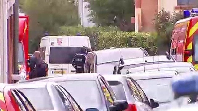 Police surround flat of suspected gunman in France