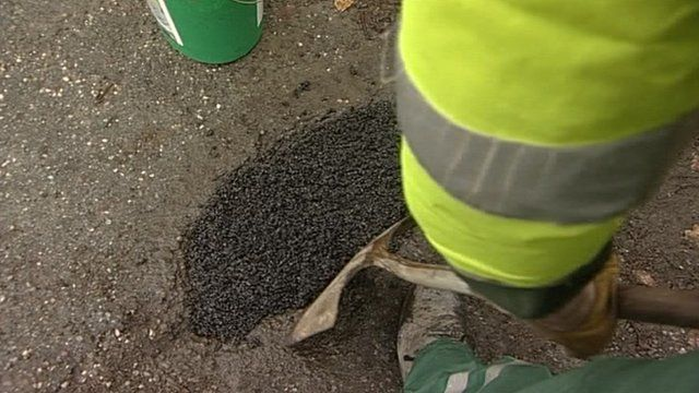 A pothole being repaired