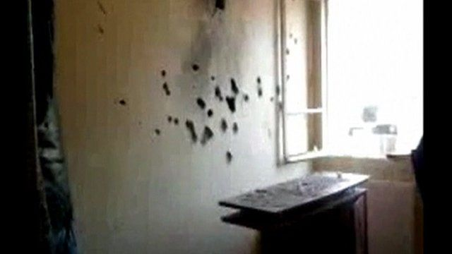 Bullet holes in the wall of the apartment of Mohamed Merah.