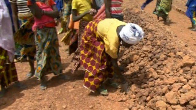 Woman building rain trap
