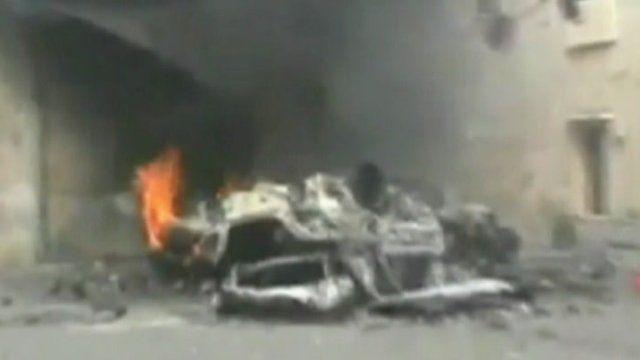 Burning car in Homs