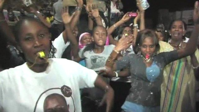 People on the streets in Dakar celebrate Senegal's election result