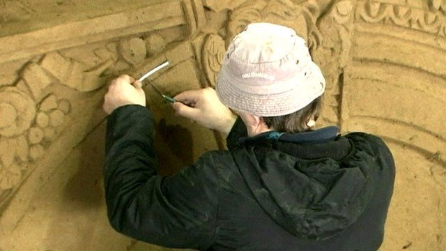 Man working on sand castle
