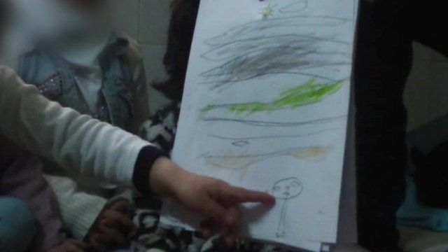 A child in Syria draws as part of art therapy