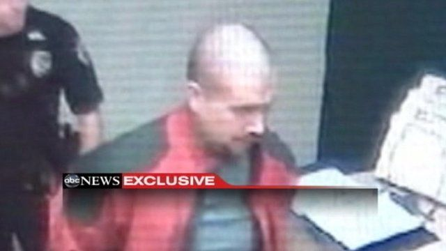 Still image of George Zimmerman being led into Sanford Police Department.