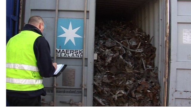 Man inspecting container