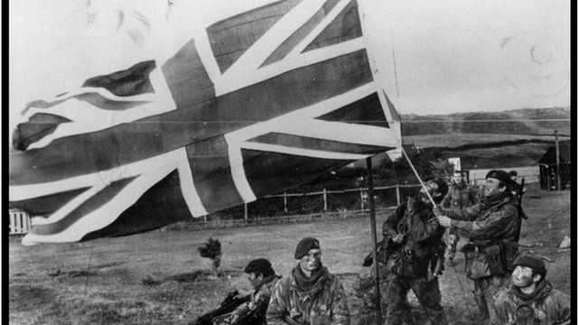 British troops raising a British flag in the Falkland Islands during the Falklands war with Argentina