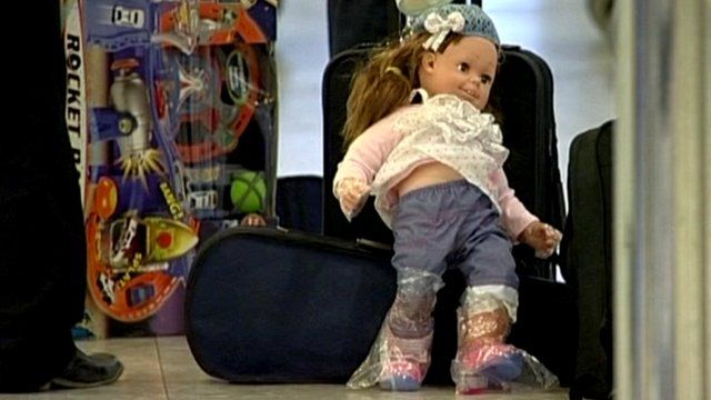 Child's luggage and doll