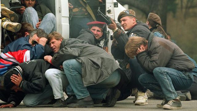 Sarajevans take cover during the initial salvoes of the war in the city