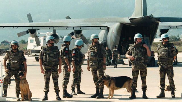 UN peackeepers at Sarajevo airport in front of a cargo plane