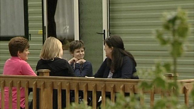 Alice Pyne with her mother and friends outside caravan