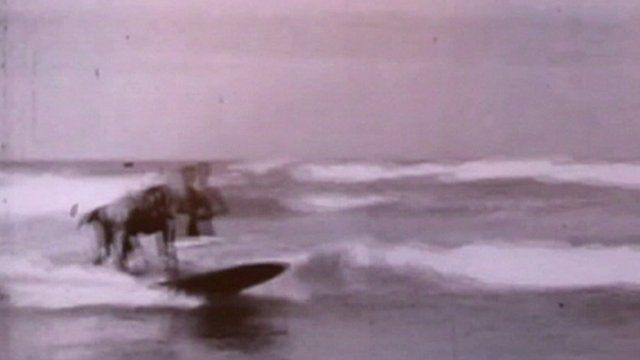 Archive still of person surfing in Bridlington